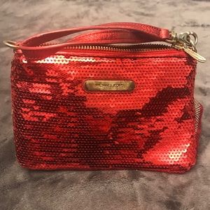 Michael Kors red sequin and leather wristlet